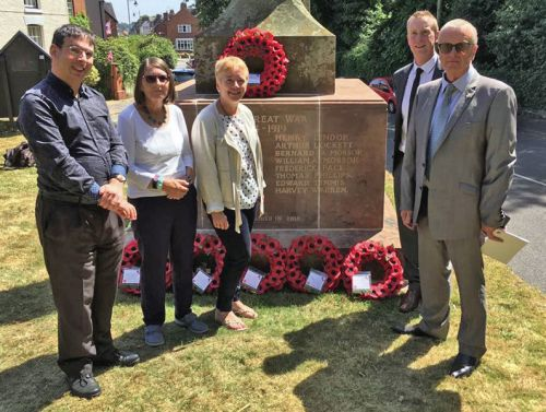 The newly unveiled War memorial at Eccleshall with 5 descendants of the Mossop family of Eccleshall. From left to right: Duncan Honeybourne, Janina Morrison, Alison Maxam, descendants of William Augustine Mossop. On the right, Rod and Stephen Mossop, descendants of his brother George